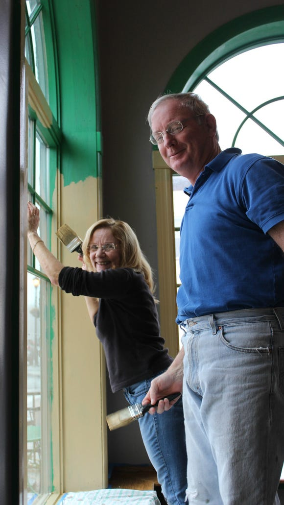 Karen and John Smith were one of a half dozen friends and family members who helped with painting Sunday.