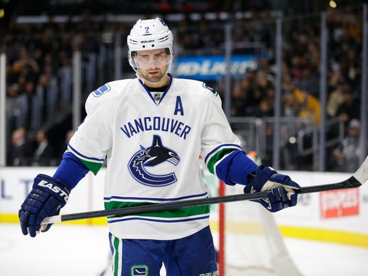 FILE - In this Dec. 1, 2015, file photo, Vancouver Canucks' Dan Hamhuis skates during the second period of an NHL hockey game against the Los Angeles Kings, in Los Angeles. Hamhuis is a hot name on the trade market. (AP Photo/Jae C. Hong, File)