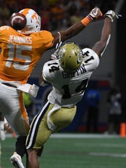 Georgia Tech defensive back Corey Griffin breaks up a pass intended for Vols wide receiver Jauan Jennings in the first half Sept. 4, 2017, in Atlanta.