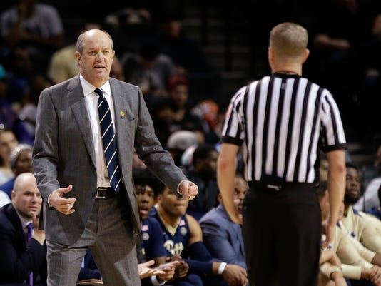 Pittsburgh head coach Kevin Stallings argues a call with a referee during the first half of an NCAA college basketball game against Notre Dame in the first round of the Atlantic Coast Conference tournament Tuesday, March 6, 2018, in New York. (AP Photo/Frank Franklin II)