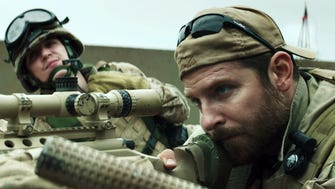 """Kyle Gallner, left, and Bradley Cooper appear in a scene from """"American Sniper."""""""