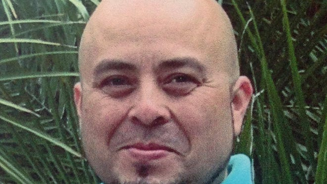 This June 2013 file photo released by the Hernandez family shows Transportation Security Administration officer Gerardo Hernandez.