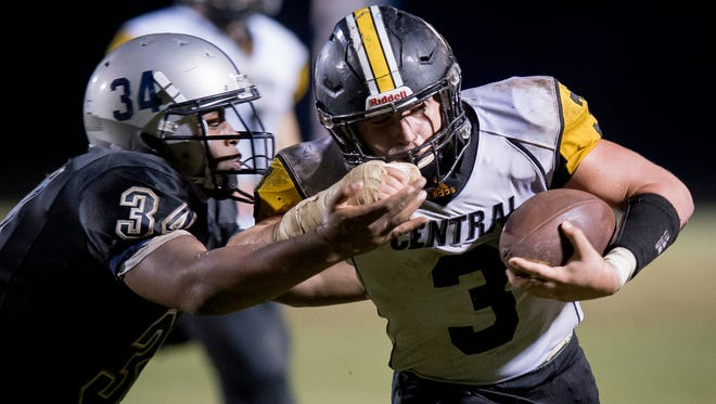 Johnson Central's Devin Johnson (3) runs around Moore's DeMarion Travis for a touchdown during the game played at Moore Traditional School, Friday, September 15, 2017.