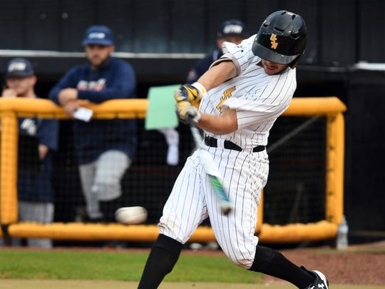 Southern Miss' Gabe Montenegro swings for the ball