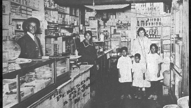 This 1924 photograph shows the interior of Pearson's store and on the right, the family to whom he was devoted: from left to right, daughter Iola Pearson Byers, son Edward W. Pearson Jr., wife Annis Bradshaw Pearson, and daughter Annette Pearson Cotton.