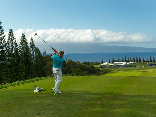 Russell Henley drives off the 18th tee during the first round of the Tournament of Champions golf tournament, Friday, Jan. 9, 2015, in Kapalua, Hawaii. (AP Photo/Marco Garcia)