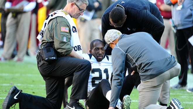 New Orleans Saints cornerback Keenan Lewis (21) is looked at by trainers after suffering an apparent leg injury against the Redskins in November. Lewis was released by the Saints on Friday.