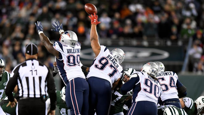New England Patriots defensive tackle Alan Branch (97) blocks a Jets field goal attempt in the second quarter.