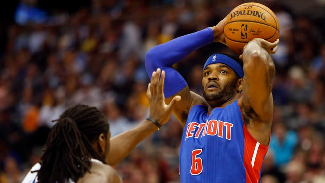 Detroit Pistons forward Josh Smith (6) shoots the ball over Denver Nuggets forward Kenneth Faried (35) on Oct. 29, 2014.