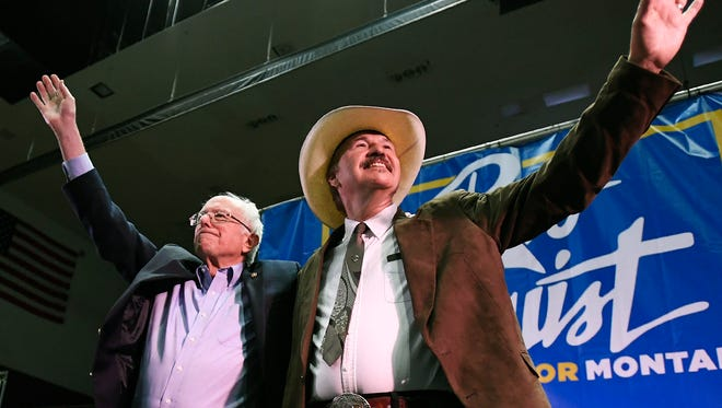 Sen. Bernie Sanders, left, and Rob Quist wave to the crowd after the conclusion of Sanders' speech on May 20 at the Adams Center on the University of Montana campus.