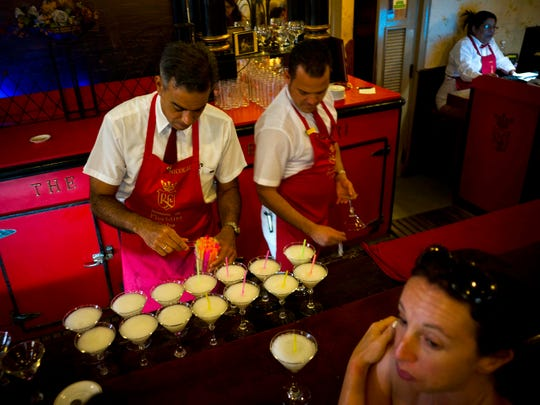 In this Friday, April 28, 2017 photo, bartenders prepare daiquiris with Cuban Havana Club rum at the Floridita bar in Havana, Cuba. The agency that controls Pennsylvania's state-owned wine and liquor stores is working to lift the embargo on Cuban rum. (AP Photo/Ramon Espinosa)