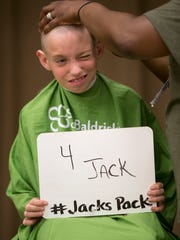 Ian Gregory, 9, supports the cause at Jack Klein day, an event raising money for childhood cancer to honor Klein, a local boy who died in from the disease, Indianapolis, Saturday, June 2, 2018. The head-shaving event is coupled with St. Baldrick's Foundation.