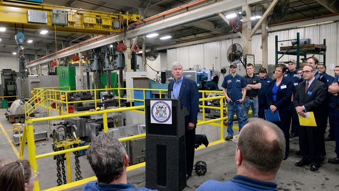 Michigan Gov. Rick Snyder speaks at Franchino Mold and Engineering, Wednesday, Jan. 21, 2015, in Lansing,. Snyder was promoting apprenticeships in the skilled trades.
