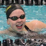 Ursuline Academy senior Sydney Lofquist smiles as she looks at her time in the 200 IM. She defended her state title in the event.