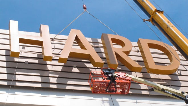 Part of the first sign for the soon-to-open Hard Rock Casino in Atlantic City N.J. is lifted into place at the building on Friday May 4, 2018.