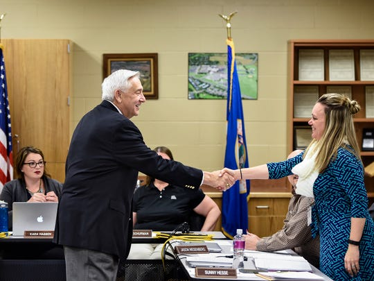 Possible acting superintendent John Thein shakes hands with Rocori School Board members before the start of a meeting Tuesday, April 3, at the district offices in Cold Spring.