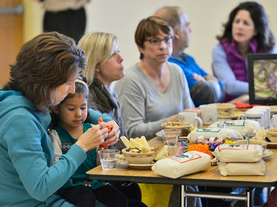 Attendees at the luncheon get to try traditional Guatemalan food Sunday at St. Peter's Catholic Church.