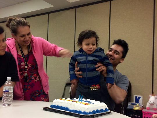 Allan Rivera and Lelin Romero help their son, Nathan, celebrate his second birthday with a cake provided by the American Red Cross during the family's stay at the Pigeon Forge Community Center in the weeks after the Gatlinburg wild fires destroyed their rental cabin.