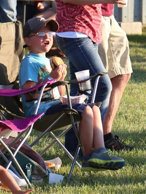 Kaden Buchanan, 7, intently watches the Motocross Freestyle AirBash in the Beer Gardens at the Sting Sports Bar on Friday evening.