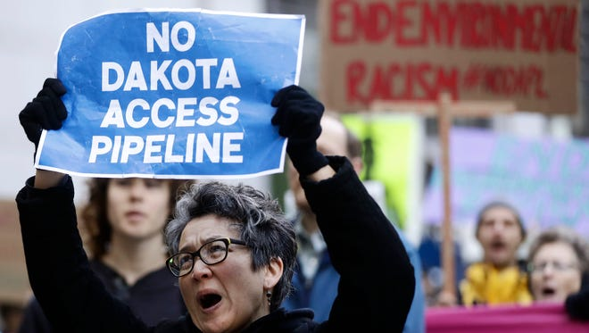 Protesters demonstrate in solidarity with members of the Standing Rock Sioux tribe in North Dakota over the construction of the Dakota Access oil pipeline in Philadelphia, Dec 1, 2016.