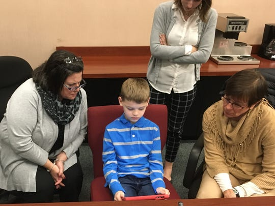 Stony Brook third grader Landon Smith teaches Central York Board Members Marie Damiano and Barbara Johnson some coding skills