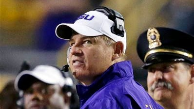 LSU coach Les Miles says his team's defense has improved since the Tigers' loss to Mississippi State two weeks ago.