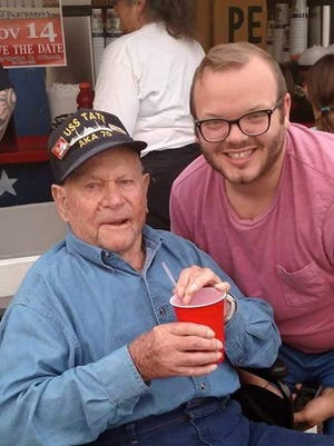 """Charles Snellings (right) poses at the Chincoteague carnival grounds with his late grandfather Harold """"Sam"""" Russell."""