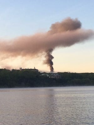 Smoke from an early morning fire at the former Hudson River Psychiatric Center.