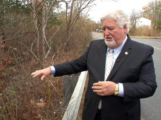 Retired Ocean County Prosecutor's Office Chief James A. Churchill revisits the spot along Garfield Avenue in Toms River Wednesday, November 11, 2015, nearly 30 years after Barbara Renee Harrison's body was found there.  Shawn Milne was convicted of her murder when he was 15,and is set to be released from prison. ~