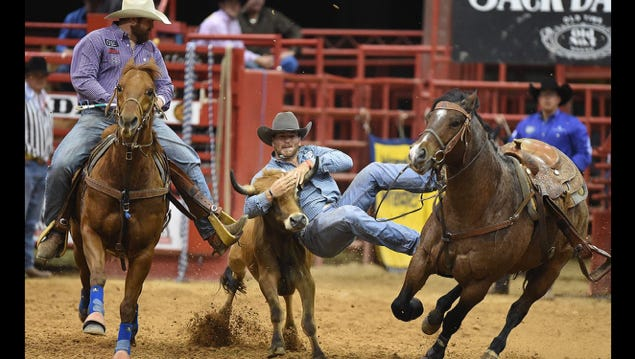 Keatchie's Jacob Talley wrestles a steer to the graound at a rodeo event. The former Calvary football player will compete at the NFR in December.