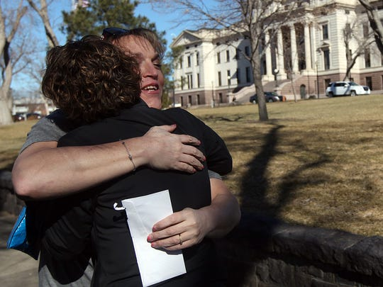 Hope Errico Wisneski, with the Regional Field Director at Human Rights Campaign, hugs Kendall Balentine (facing camera), of the Black Hills, outside the State Capitol in Pierre on Tuesday, Feb. 23, 2016.
