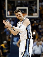 FILE - In this April 26, 2014, file photo, Memphis Grizzlies forward Mike Miller celebrates a score against the Oklahoma City Thunder during overtime in Game 4 of an opening-round NBA basketball playoff game in Memphis, Tenn. A person familiar with the negotiations says the free agent has agreed to a 2-year, $5.5 million contract with the Cleveland Cavaliers, re-uniting him with superstar LeBron James. (AP Photo/Mark Humphrey, File)