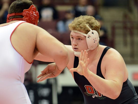 Oak Harbor's Brandon Garber, right, wrestles Hamler