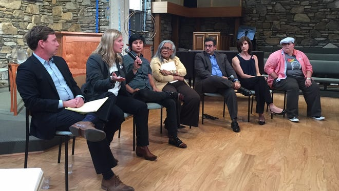 Local attorney Meghann Burke, second from left, speaks during a meeting on HB2 in Asheville Thursday.