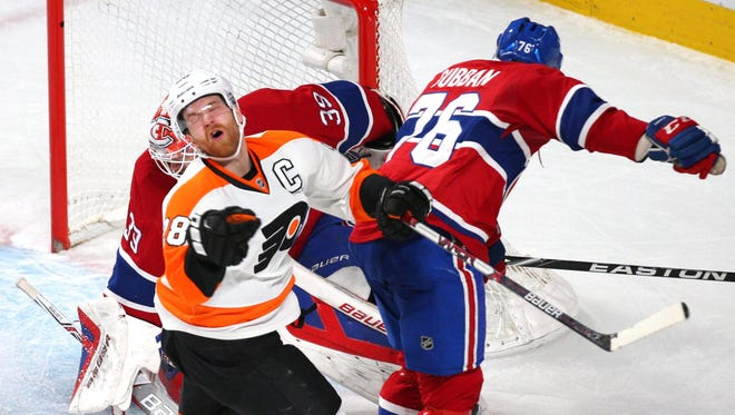 The Flyers' Claude Giroux finished Friday night's game after taking a hit from the Canadiens' P.K. Subban.