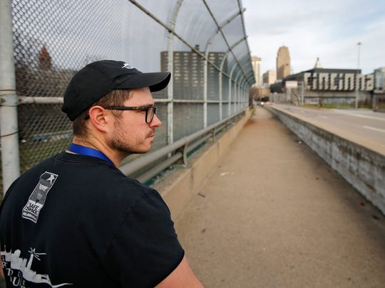 Lighthouse Street Outreach Case Manager Ryan Hall, walks along the Sixth Street Viaduct in search of homeless people in need of help, Thursday, March 9, 2017, in downtown Cincinnati.