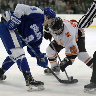 Salem's Zach Goleniak (18) rips a shot over the shoulder of Northville goalie Chance Boutin in Wednesday's Division 1 pre-regional at Arctic Edge.