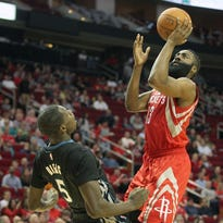 Mar 27, 2015; Houston, TX, USA; Houston Rockets guard James Harden (13) shoots against Minnesota Timberwolves center Gorgui Dieng (5) in the first quarter at Toyota Center. Mandatory Credit: Thomas B. Shea-USA TODAY Sports