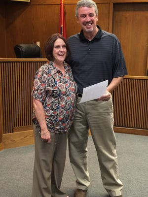 Gail Davis Wren was honored by the Dickson County Commission with a resolution last week. Here she's pictured with County Mayor Bob Rial when receiving the resolution.