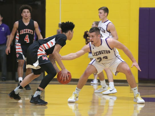 Lexington's Cade Stover guards Mount Vernon's Tyler