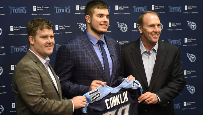 Titans general manager Jon Robinson, first round draft pick Jack Conklin from Michigan State University and head coach Mike Mularkey are introduced during a press conference at St. Thomas Sports Park.