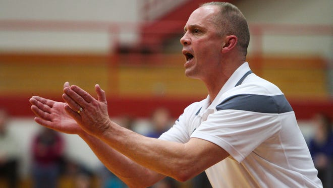 Bedford North Lawrence head coach Jeff Allen guides his team during the second half of play against New Albany during the 40th Annual Girls' Basketball Sectional Tournament at Jeffersonville High School. February 10, 2015.