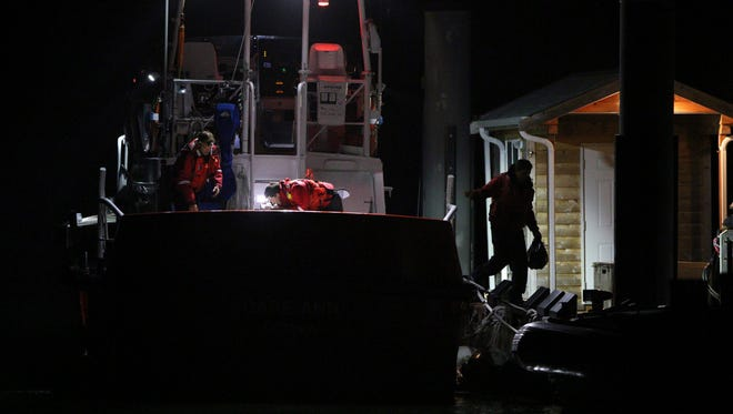 Canadian Coast Guard crew arrive at a dock in Tofino, west coast of Vancouver, on Oct. 26, 2015, following a search and rescue operation for a whale-watching boat that capsized off Vancouver Island.