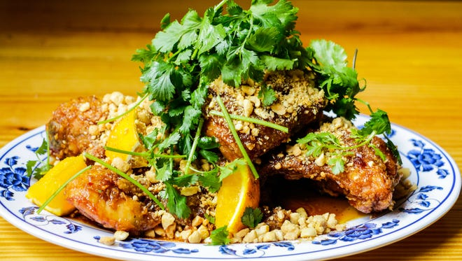 Try the General's Chicken, deep fried chicken with bourbon soy, peanuts and cilantro.