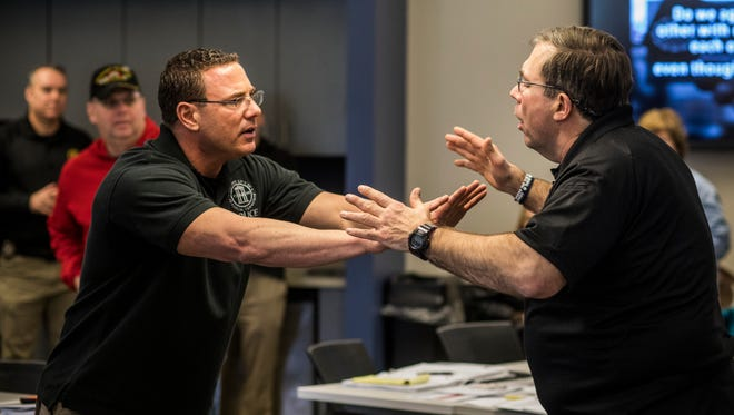 Franklin Police Public Affairs Officer Ryan Schuman practices de-escalation tactics with Vistelar co-founder Gary Klugiewicz during a class at the Williamson County Public Safety Center Building.