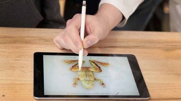 The new 9.7-inch iPad is used to demonstrate the dissecting