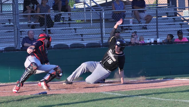 The Acadiana Cane Cutters catcher dives trying to tag out a Texarkana baserunner during the Cutters' second straight home win Friday at Fabacher Field.