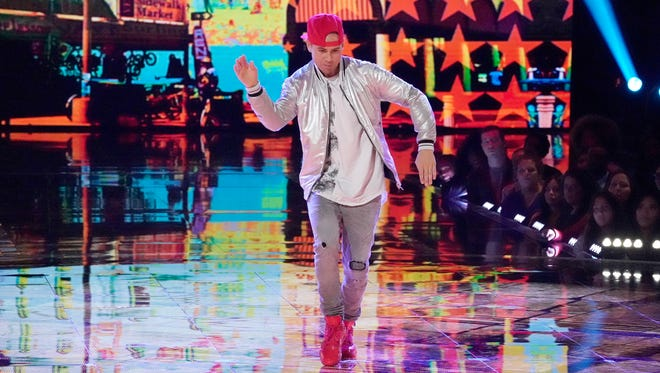 "Farmington native Poppin John performs during The Duels round of competition Sunday on the third season of NBC-TV's ""World of Dance."""