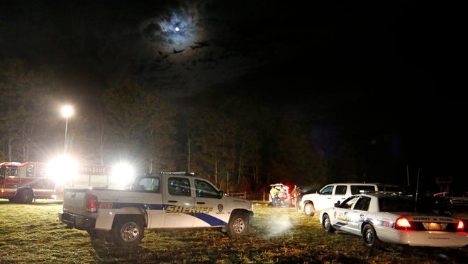 Emergency personnel work at the site Oct. 11, 2014, of a hayride rollover that injured 22 people and killed one at Harvest Hill Farms in Mechanic Falls, Maine.