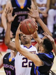 Madison East's D'Angelo Millon (22) defends against Germantown's Juwan McCloud during the first half of their Division 1 semifinal.